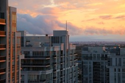 Brilliant Colorful Sunset Over Condo Buildings With Cityscape In The Background In Vaughan Ontario Canada