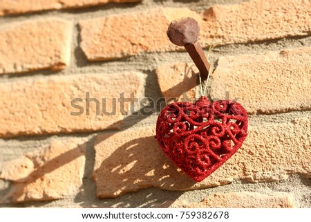 Free photos A heart ornament hanging on the wall | Avopix.com