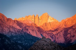 Brilliant sunrise on the face of Mount Whitney in the Owens Valley of California.