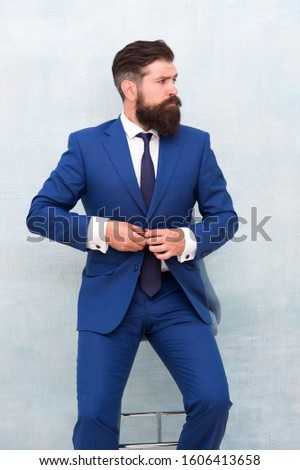 Bring chic and fashionable tone to office wear. Bearded man button fashionable suit jacket. Fashionable look of busy man. Fashionable office wardrobe. Fashion and style.