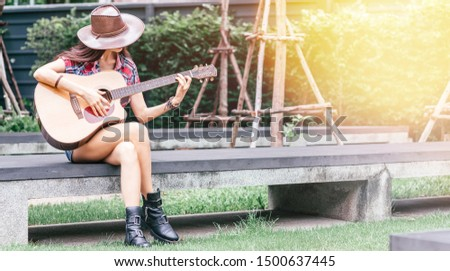 Bring harmony to the world. Beautiful cowgirl perfoming outdoors. Copy space on the right side