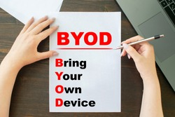 Bring your own device (byod) the girl writes on paper next to her laptop