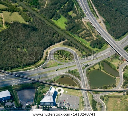 BRISBANE AIRPORT, AUSTRALIA - : Freeway junctions feeding traffic into Brisbane Airport with Kedron Brook, and Gateway Motorway on right, feeding Airport Drive, East-West Arterial Road, Moreton Drive. #1418240741