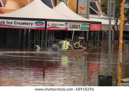 BRISBANE, AUSTRALIA - JAN 13 : Flooded  Brisbane auchenflower area police and army patrol January 13, 2011 in Brisbane, Australia