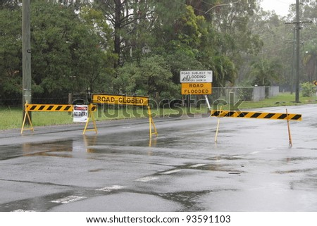 BRISBANE, AUSTRALIA - JAN 25 : One year on Brisbane flooding again, old bay road closed Burpengay January 25, 2012 in Brisbane, Australia