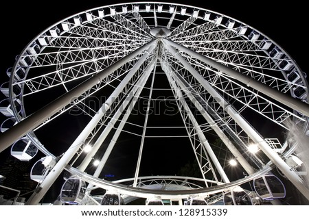 BRISBANE, AUSTRALIA - Jun 26 : Ferries wheel in Brisbane's Southbank at night, generic wheel that you see everywhere around the world.  Brisbane 26 2010