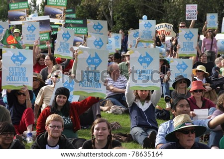BRISBANE, AUSTRALIA - JUNE 6 : crowds with say Yes to cutting carbon pollution and clean energy signs at rally during World Environment Day say yes protest 6, 2011 in Brisbane, Australia