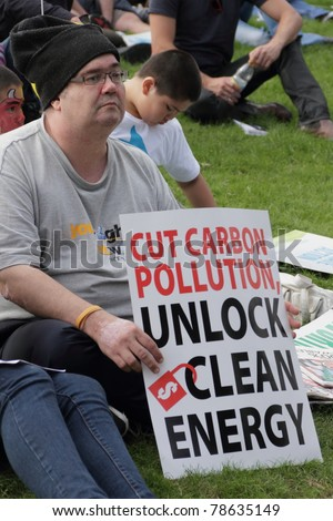 BRISBANE, AUSTRALIA - JUNE 6 : man with clean energy protest sign at say Yes rally  during World Environment Day 6, 2011 in Brisbane, Australia