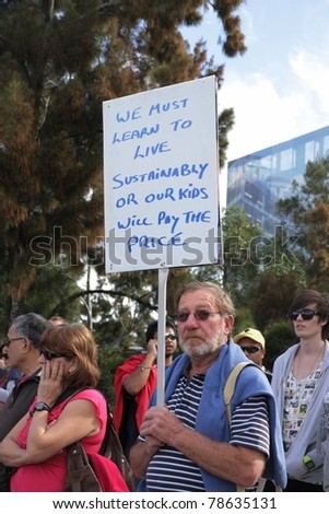 BRISBANE, AUSTRALIA - JUNE 6 : man with sustainability sign during World Environment Day say yes protest 6, 2011 in Brisbane, Australia