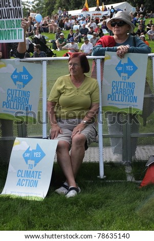 BRISBANE, AUSTRALIA - JUNE 6 : older women with cut pollution and say yes to carbon tax protest signs at during World Environment Day rally 6, 2011 in Brisbane, Australia