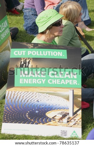 BRISBANE, AUSTRALIA - JUNE 6 : Woman with anti polution clean energy sign at say Yes to carbon tax World Environment Day protest 6, 2011 in Brisbane, Australia