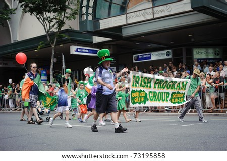 BRISBANE, AUSTRALIA - MAR 12: An unidentified old man holding a placard marches to celebrate St Patrick's day on Mar 12, 2011 at the Elizabeth st, Brisbane, Australia.