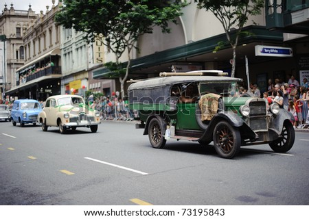 BRISBANE, AUSTRALIA - MAR 12: Various classic cars march to celebrate St Patrick's day on Mar 12, 2011 at the Elizabeth st, Brisbane, Australia. - stock photo