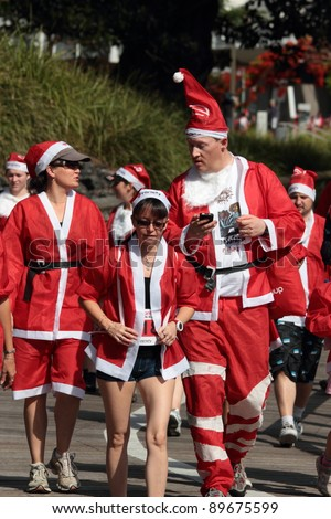 BRISBANE, AUSTRALIA  NOV 27 :Unidentified people of all backgrounds take part in the Variety Santa Fun Run November 27, 2011 in Brisbane, Australia