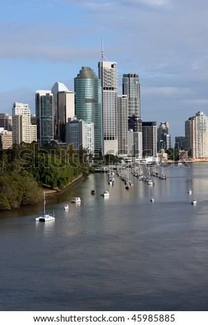 Brisbane, Capital of Queensland Australia.  Picture highlights the Brisbane River, Botanic Gardens and City Skyline featuring some of the city's iconic features. - stock photo