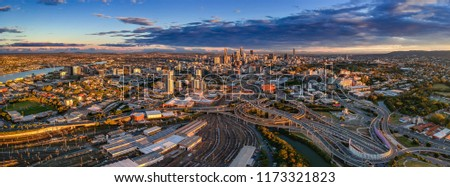 Brisbane city business district and suburbs panorama at sunset #1173321823