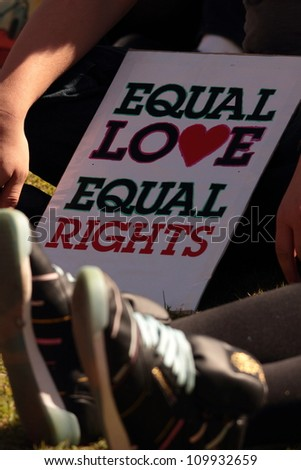 BRISBANE, QLD AUSTRALIA - AUGUST 11 : equal love sign amongst crowd on August 11 2012  in Brisbane, Australia  Equal Love is a gay rights group supporting gay marriage