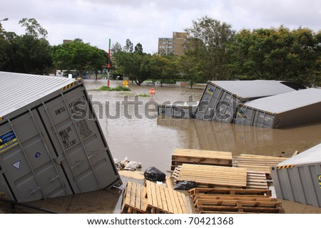 BRISBANE, QUEENSLAND/AUSTRALIA - JANUARY 13: Flooded shipping container park on January 13, 2011 in St Lucia, Brisbane, Queensland, Australia.