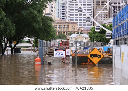 BRISBANE, QUEENSLAND/AUSTRALIA - JANUARY 13: Flooded street with Farris wheel on January 13, 2011 in South Bank, Brisbane, Queensland, Australia.