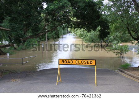BRISBANE, QUEENSLAND/AUSTRALIA - JANUARY 13: Road closed sign in front of a flooded street on January 13, 2011 in Toowong, Brisbane, Queensland, Australia.