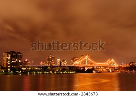 Brisbane river by evening with Story bridge in background - stock photo