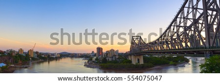 Brisbane's Story bridge at sunset with the Brisbane river #554075047