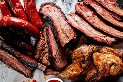 Brisket, pork ribs, beef ribs, chicken, pork sausage. Barbecue meat platter served with classic bbq sides Mac n cheese, cornbread, coleslaw & beer. Classic traditional Texas meats & side dishes.