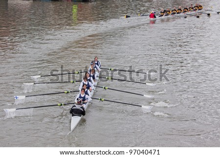 BRISTOL, ENGLAND - FEBRUARY 19: Crew from the Bristol Ariel Rowing Club in pursuit of a rival team in the annual Head of the River race in Bristol, England on February 19, 2012. 100 teams entered.