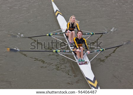 BRISTOL, ENGLAND - FEBRUARY 19: Two woman crew from the Avon County Rowing Club racing in the annual Head of the River race Bristol, England on February 19, 2012. One hundred teams entered the event