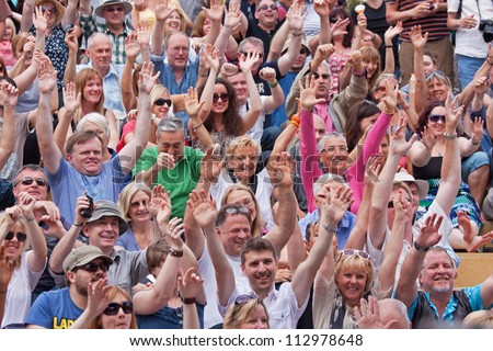 BRISTOL, ENGLAND - JULY 21:  An audience at the 41st Bristol Harbour Festival on July 21, 2012. An estimated 300,000 people attended the largest event of its type in Europe over its three days