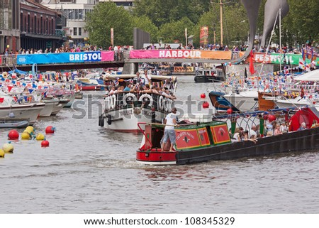 BRISTOL, ENGLAND - JULY 21:  Record numbers flocked to the city docks for the annual Harbour Festival in Bristol, England on July 21, 2012. An estimated 300,000 people attended the three day event
