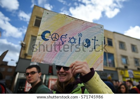 Bristol, UK - February 4, 2017: Protestersmarch through the city centre demonstrating against US President Donald Trump's UK visit and his order banning travelto the USA from seven Muslimcountries.