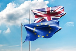 Britain and EU flag on flagpole excellent quality. The United Kingdom of Great Britain and Northern Ireland and The European Union waving flag in wind