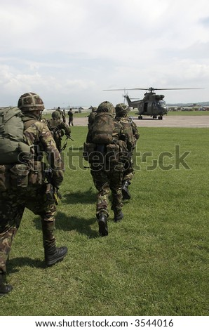 British Army soldiers board helicopter