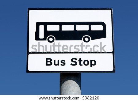 British bus stop sign and a blue sky.