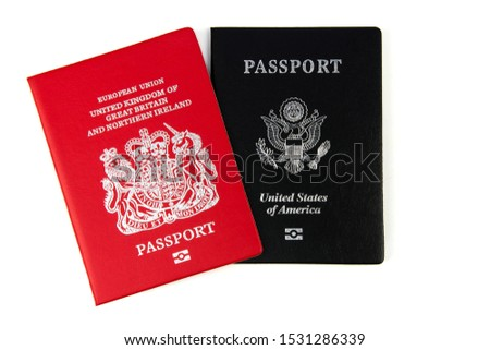 British citizen and passports USA on white background. top view.