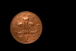 British coin 2 pence (2001) isolated on black background with space for copy text. Front side of two pence coin. England coins collectors world wide.