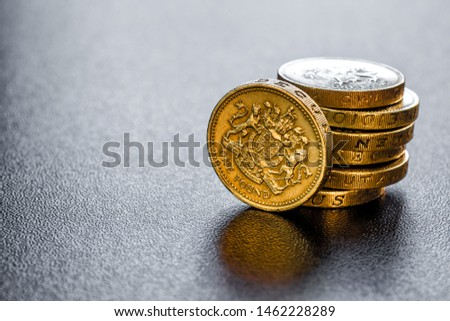 British coins stack on black, pound sterling #1462228289
