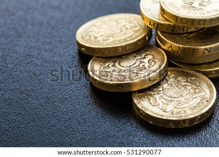 British coins stack on black, pound sterling #531290077