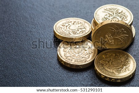 British coins stack on black, pound sterling #531290101