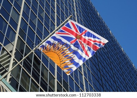 British Columbia Provincial Flag. The British Columbia Provincial Flag flying from a downtown Vancouver office tower. Canada.