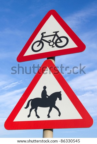 British cycle route ahead and accompanied horses or ponies, road signs.