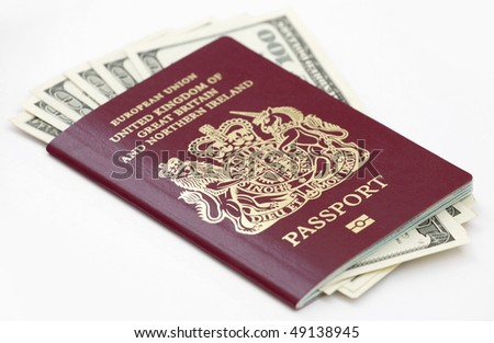 British (European Union) passport with US currency isolated on white