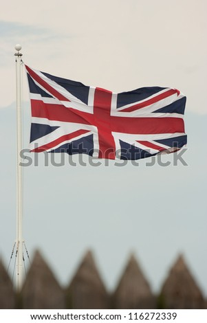 British flag or Union Jack flapping in the wind.