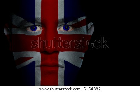 British flag painted/projected onto a man's face.