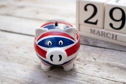British money box with calendar date of 29th March, brexit day