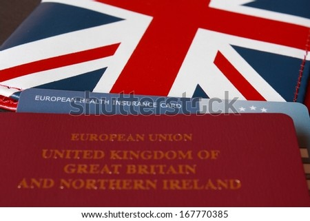 british passport with health insurance card