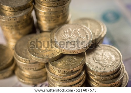 British Pound Coins against a background of British assorted bank notes   #521487673