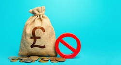 British pound sterling money bag and red prohibition sign NO. Confiscation of deposits. Termination projects. Monetary restrictions, freezing of bank accounts. Monitoring suspicious money flows.