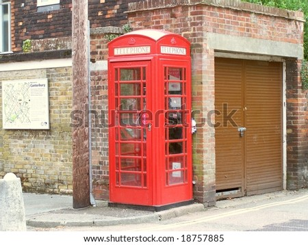 British red phone booth K6 in Canterbury, Kent + town map on the wall and car box garage
